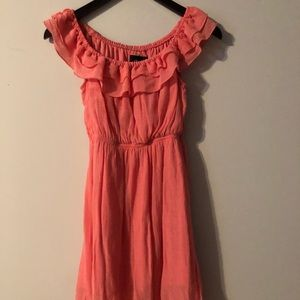 Coral dress with ruffled top.